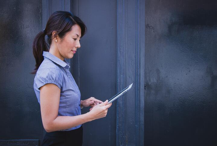 woman with iPad looking at intranet